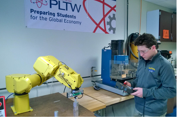 Alex programs the Fanuc Robotic arm to do a pick and place routine.